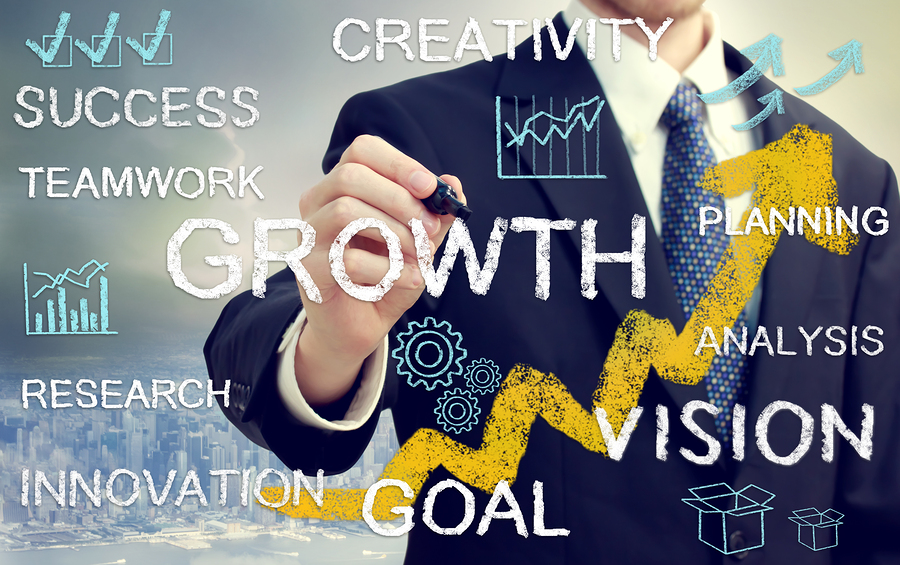 Business Man With Concepts Representing Growth, And Success